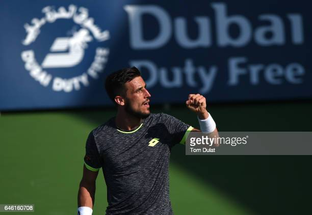 Damir Dzumhur of Bosnia and Herzegovina celebrates winning his match against Stan Warwinka of Switzerland on day three of the ATP Dubai Duty Free...