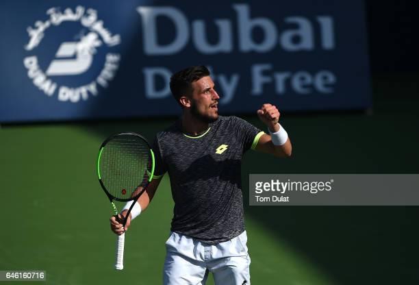 Damir Dzumhur of Bosnia and Herzegovina celebrates winning his match against Stan Wawrinka of Switzerland on day three of the ATP Dubai Duty Free...