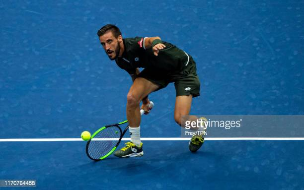 Damir Dzumhur of Bosnia and Herzegovina hits a forehand against Roger Federer of Switzerland in the second round of the US Open at the USTA Billie...