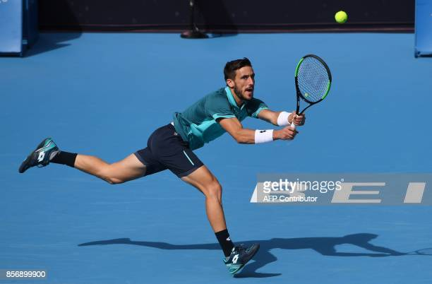 Damir Dzumhur of Bosnia and Herzegovina hits a return during his men's singles match against Grigor Dmitrov of Bulgaria at the China Open tennis...
