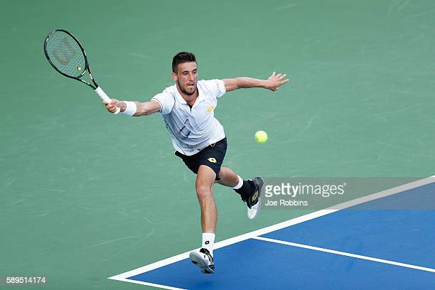 Damir Dzumhur of Bosnia and Herzegovina hits a return to Stefan Kozlov of the United States during their qualifying match on Day 2 of the Western...