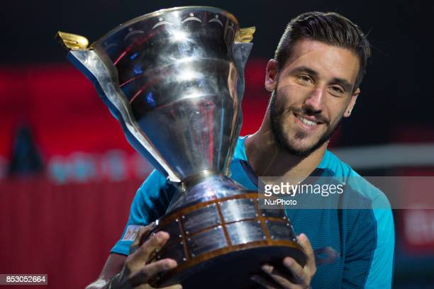 Damir Dzumhur of Bosnia and Herzegovina holds his trophy after winning in the St Petersburg Open ATP tennis tournament final match against Fabio...