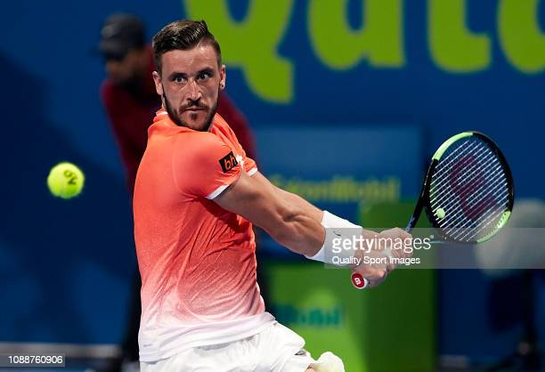 Damir Dzumhur of Bosnia and Herzegovina in action during his match against Novak Djokovic of Serbia during day two of the ATP Qatar ExxonMobil Open...