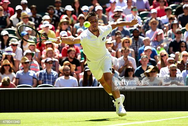 Damir Dzumhur of Bosnia and Herzegovina in action in his Gentlemen's Singles first round match against Roger Federer of Switzerland during day two of...