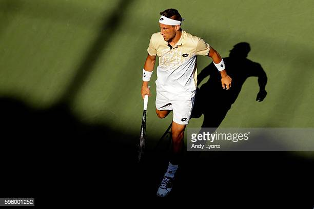 Damir Dzumhur of Bosnia and Herzegovina looks on against Bernard Tomic of Australia during his first round Men's Singles match on Day Two of the 2016...
