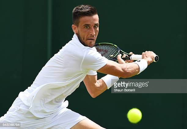 Damir Dzumhur of Bosnia and Herzegovina plays a back hand shot during the Men's Singles first round against Denis Kudla of Ukraine on day one of the...