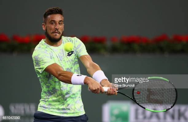Damir Dzumhur of Bosnia and Herzegovina plays a backhand against Ryan Harrison of the United States in their first round match during day four of the...