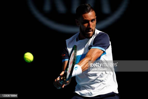 Damir Dzumhur of Bosnia and Herzegovina plays a backhand during his Men's Singles first round match against Stan Wawrinka of Switzerland on day two...