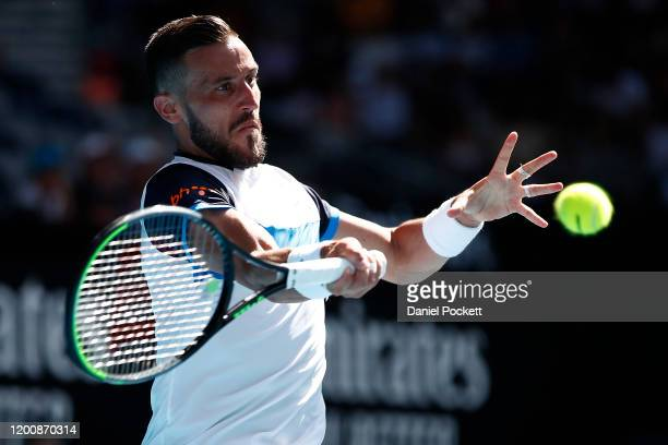 Damir Dzumhur of Bosnia and Herzegovina plays a forehand during his Men's Singles first round match against Stan Wawrinka of Switzerland on day two...