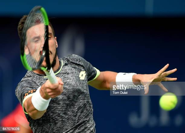 Damir Dzumhur of Bosnia and Herzegovina plays a forehand during his quarter final match against Robin Haase of Netherlands on day five of the ATP...