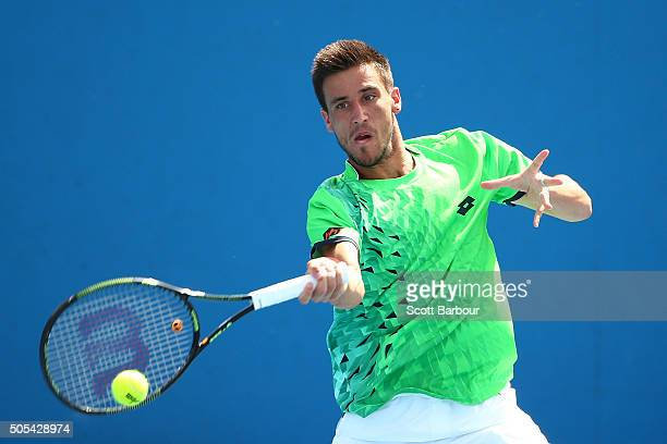 Damir Dzumhur of Bosnia and Herzegovina plays a forehand in his first round match against Kyle Edmund of Great Britain during day one of the 2016...