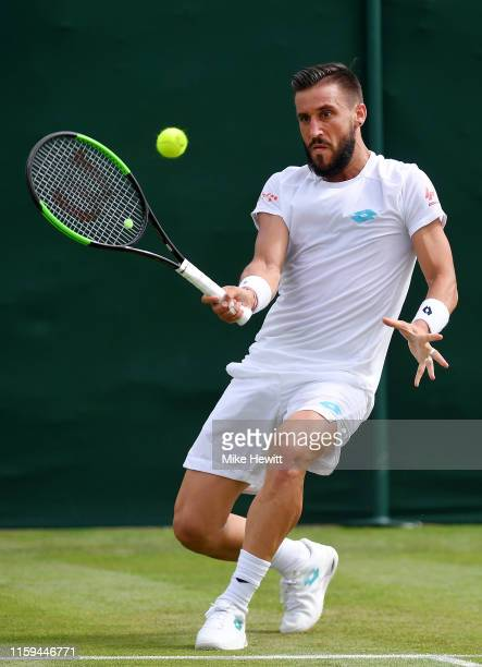 Damir Dzumhur of Bosnia and Herzegovina plays a forehand in his Men's Singles first round match against Pablo Cuevas of Uruguay during Day one of The...