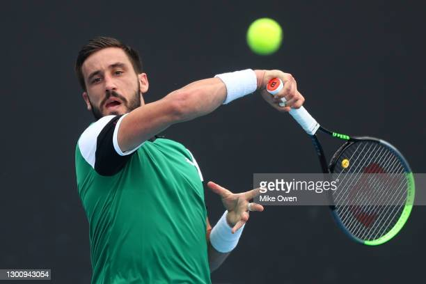 Damir Dzumhur of Bosnia and Herzegovina plays a forehand in his Men's Singles first round match against James Duckworth of Australia during day one...