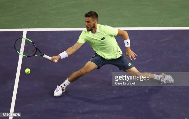Damir Dzumhur of Bosnia and Herzegovina plays a forehand volley against Ryan Harrison of the United States in their first round match during day four...