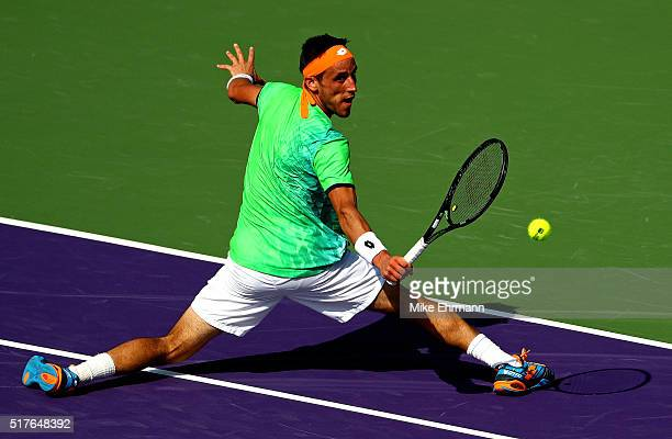 Damir Dzumhur of Bosnia and Herzegovina plays a match against Rafael Nadal of Spain during Day 6 of the Miami Open presented by Itau at Crandon Park...