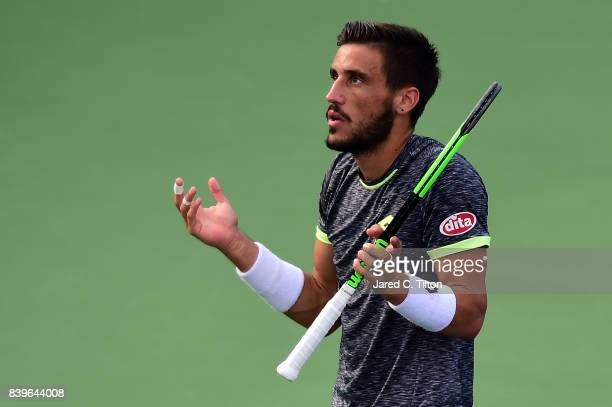 Damir Dzumhur of Bosnia and Herzegovina reacts after a point against Roberto Bautista Agut of Spain during the men's singles championship final of...