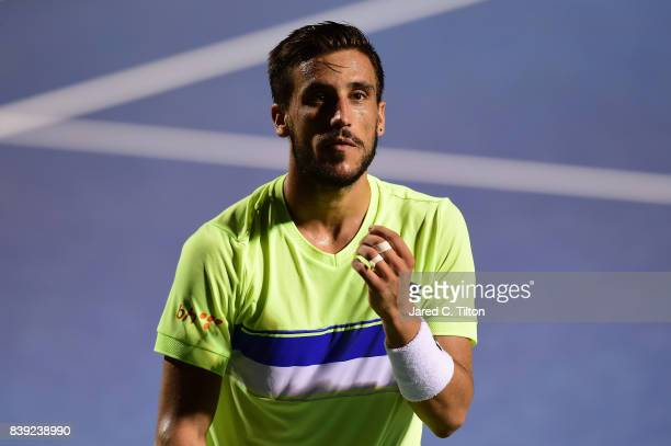 Damir Dzumhur of Bosnia and Herzegovina reacts after defeating Kyle Edmund of Great Britain in their semifinals match in the Winston-Salem Open at...