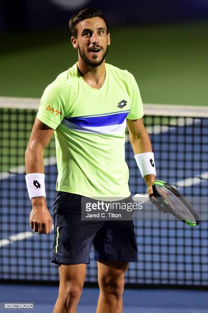 Damir Dzumhur of Bosnia and Herzegovina reacts after defeating Kyle Edmund of Great Britain in their semifinals match in the WinstonSalem Open at...
