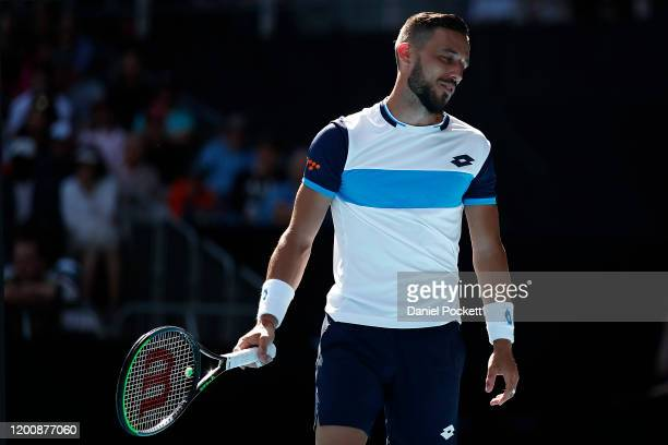 Damir Dzumhur of Bosnia and Herzegovina reacts during his Men's Singles first round match against Stan Wawrinka of Switzerland on day two of the 2020...