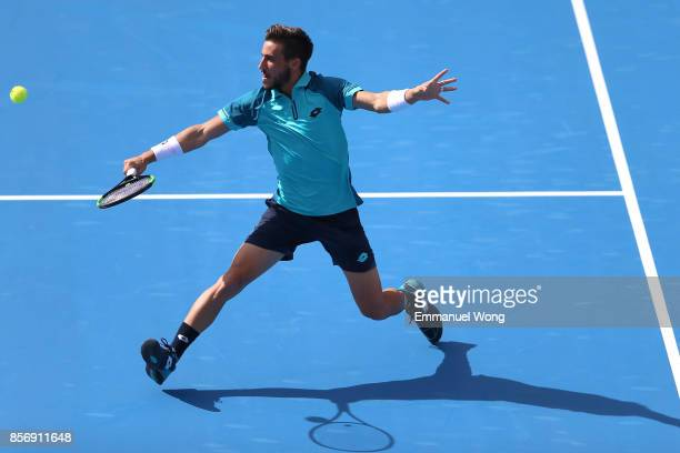 Damir Dzumhur of Bosnia and Herzegovina returns a shot against Grigor Dimitrov of Bulgaria on day four of the 2017 China Open at the China National...