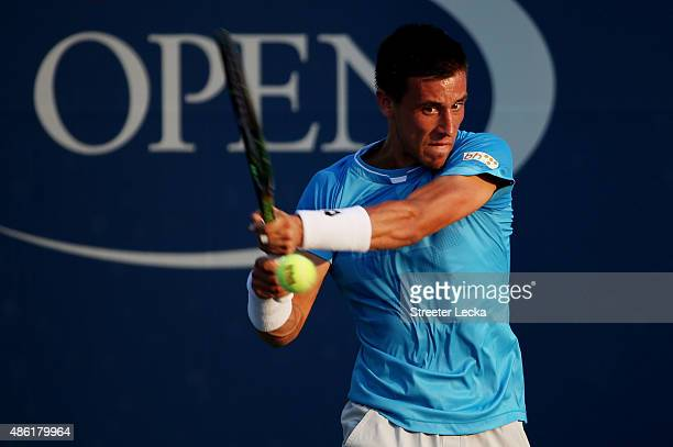 Damir Dzumhur of Bosnia and Herzegovina returns a shot against Bernard Tomic of Australia during their Men's Singles First Round match on Day Two of...
