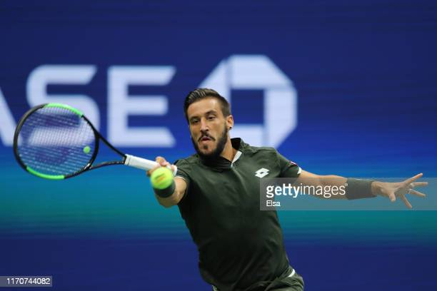 Damir Dzumhur of Bosnia and Herzegovina returns a shot during his Men's Singles second round match against Roger Federer of Switzerland on day three...