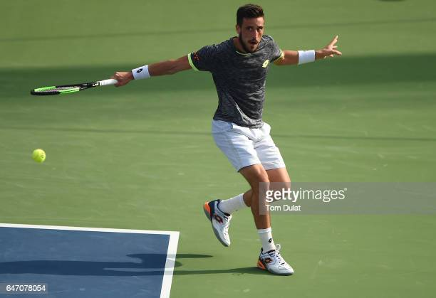 Damir Dzumhur of Bosnia and Herzegovina returns a shot during his quarter final match against Robin Haase of Netherlands on day five of the ATP Dubai...