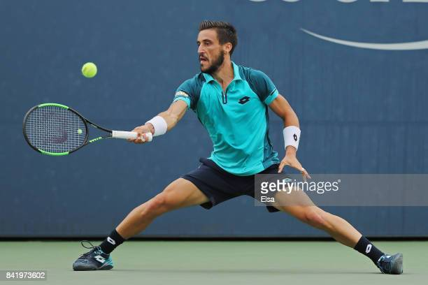 Damir Dzumhur of Bosnia and Herzegovina returns a shot to Andrey Rublev of Russia during their third round match on Day Six of the 2017 US Open at...