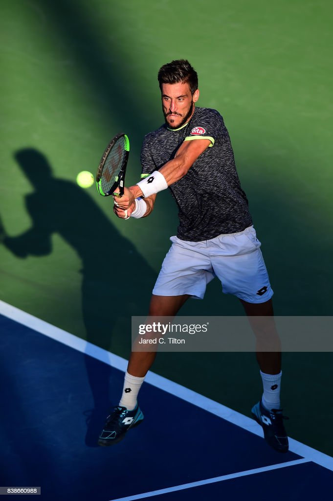 Damir Dzumhur of Bosnia and Herzegovina returns a shot to Hyeon Chung of Korea during their quarterfinals match of the Winston-Salem Open at Wake Forest University on August 24, 2017 in Winston-Salem, North Carolina.