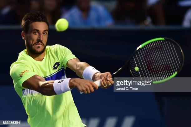 Damir Dzumhur of Bosnia and Herzegovina returns a shot to Kyle Edmund of Great Britain during their semifinals match in the Winston-Salem Open at...