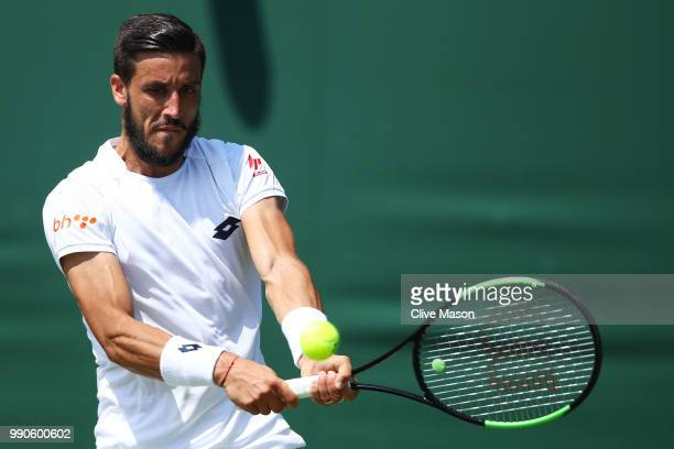 Damir Dzumhur of Bosnia and Herzegovina returns against Maximilian Marterer of Germany during their Men's Singles first round match on day two of the...
