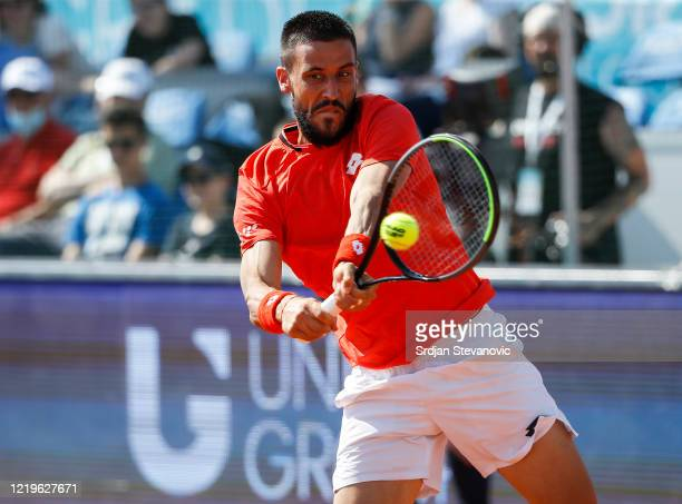 Damir Dzumhur of Bosnia and Herzegovina returns the ball to Dominic Thiem of Austria during the Adria Tour charity exhibition hosted by Novak...