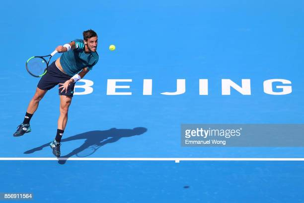 Damir Dzumhur of Bosnia and Herzegovina serves against Grigor Dimitrov of Bulgaria on day four of the 2017 China Open at the China National Tennis...
