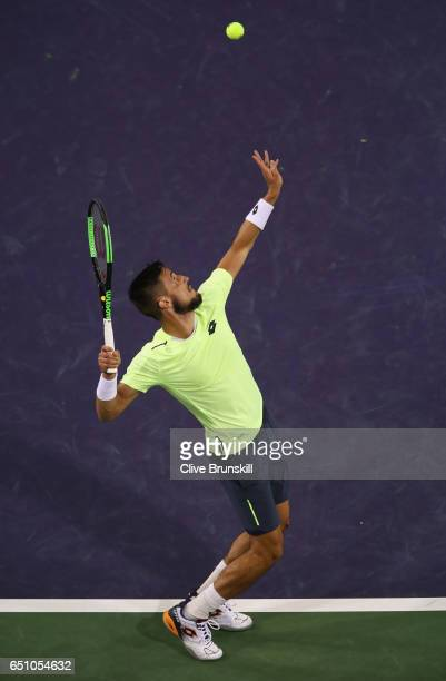 Damir Dzumhur of Bosnia and Herzegovina serves against Ryan Harrison of the United States in their first round match during day four of the BNP...