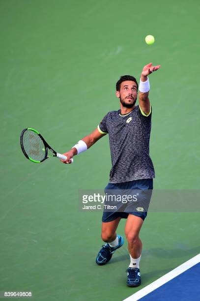 Damir Dzumhur of Bosnia and Herzegovina serves to Roberto Bautista Agut of Spain during the men's singles championship final of the WinstonSalem Open...