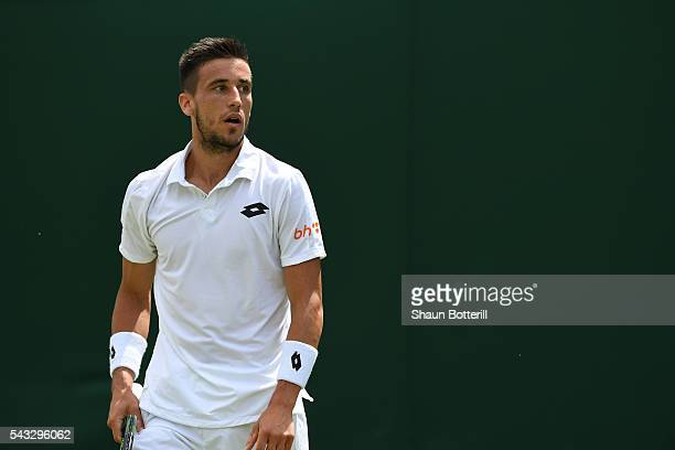 7 Damir Dzumhur of Bosnia and Herzegovinalooks on during the Men's Singles first round against Denis Kudla of Ukraine on day one of the Wimbledon...