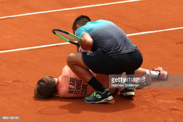 Damir Dzumhur of Bosnia and Herzegovinia colides with a ball boy during his mens singles third round match against Alexander Zverev of Germany during...