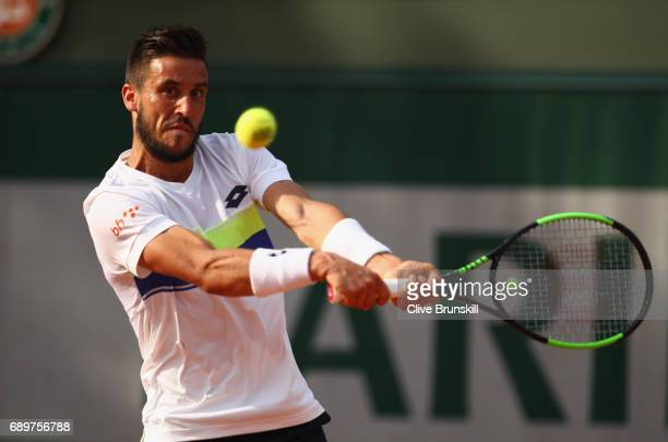 Damir Dzumhur of Bosnia and Herzegovinia plays a backhand during the mens singles first round match against Nicolas Kicker of Argentina on day two of...