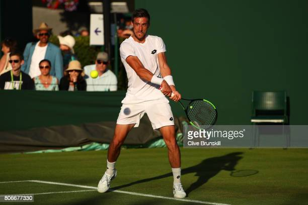 Damir Dzumhur of Bosnia and Herzegovinia plays a backhand during the Gentlemen's Singles first round match against Renzo Olivo of Argentina on day...