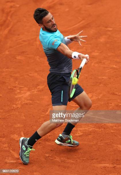 Damir Dzumhur of Bosnia and Herzegovinia plays a forehand during his mens singles third round match against Alexander Zverev of Germany during day...