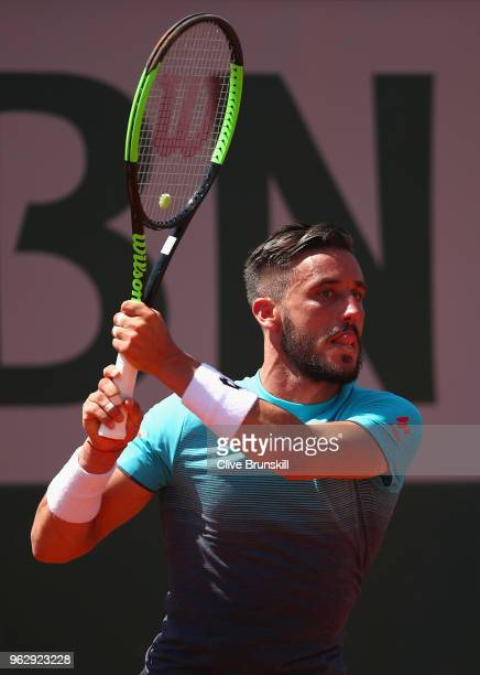 Damir Dzumhur of Bosnia and Herzegovvina in action against Denis Kudla of the United States in their first round mens singles match on day one of the...
