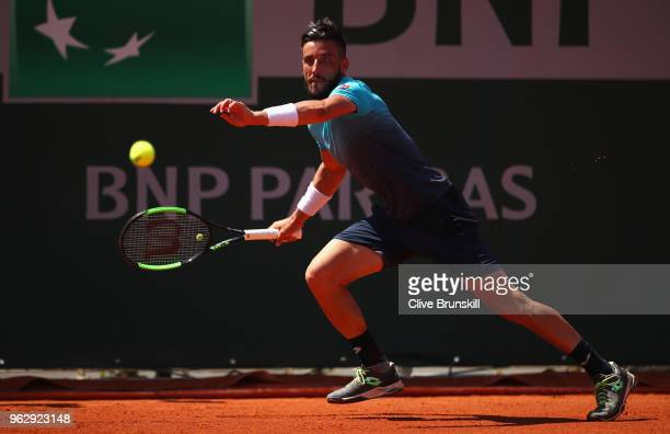 Damir Dzumhur of Bosnia and Herzegovvina plays a forehand against Denis Kudla of the United States in their first round mens singles match on day one...