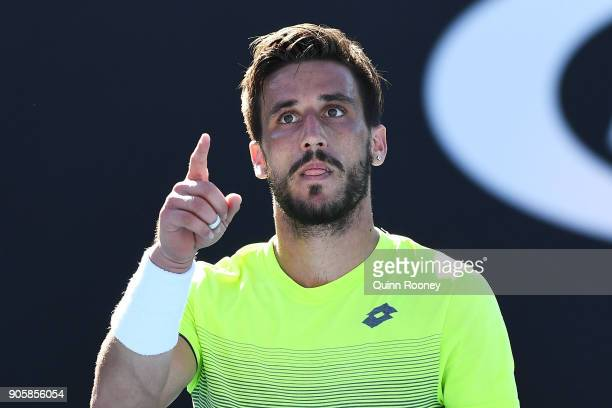 Damir Dzumhur of Bosnia and Herzogovina celebrates winning match point in his second round match against John Millman of Australia on day three of...