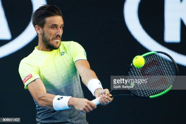 Damir Dzumhur of Bosnia and Herzogovina plays a backhand in his third round match against Rafael Nadal of Spain on day five of the 2018 Australian...