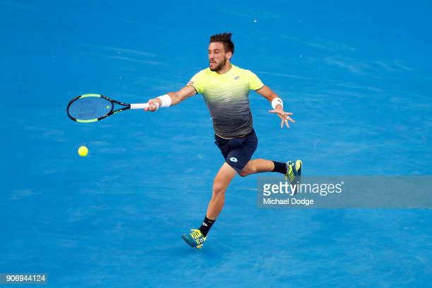 Damir Dzumhur of Bosnia and Herzogovina plays a forehand in his third round match against Rafael Nadal of Spain on day five of the 2018 Australian...