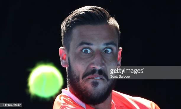 Damir Dzumhur of Bosnia / Herzegovina watches the ball as he plays a shot during his rubber 1 singles match against John Millman of Australiaduring...