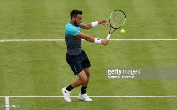 Damir Dzumhur of Bosnia plays a backhand during his match against Grigor Dimitrov of Bulgaria on Day Two of the FeverTree Championships at Queens...