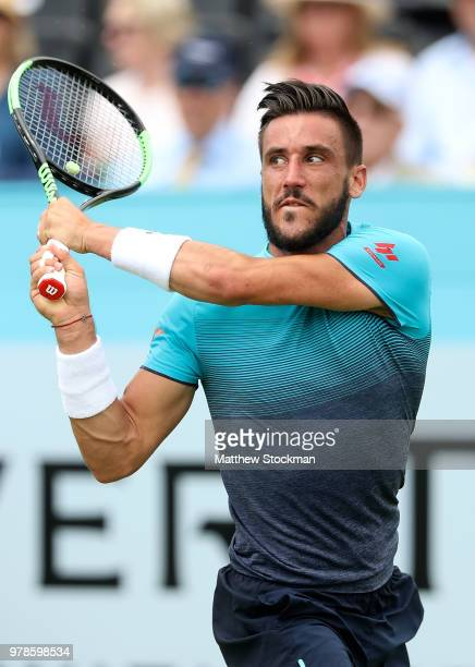 Damir Dzumhur of Bosnia plays a backhand during his match against Grigor Dimitrov of Bulgaria on Day Two of the Fever-Tree Championships at Queens...