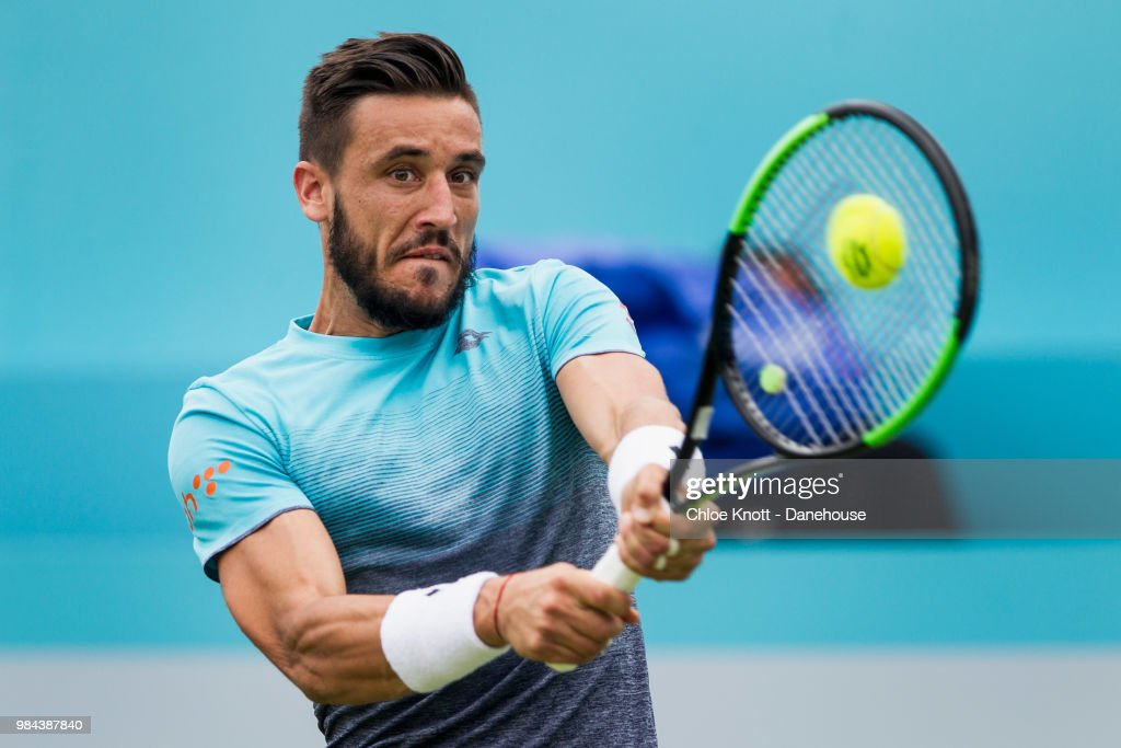 Damir Dzumhur of Bosnia plays a backhand shot during his match against Grigor Dimitrov of Bulgaria on day two of the Fever-Tree Championships at Queens Club on June 19, 2018 in London, United Kingdom.