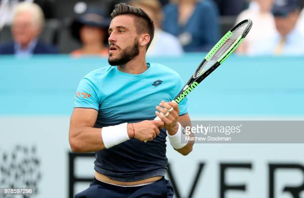 Damir Dzumhur of Bosnia plays a forehand during his match against Grigor Dimitrov of Bulgaria on Day Two of the FeverTree Championships at Queens...